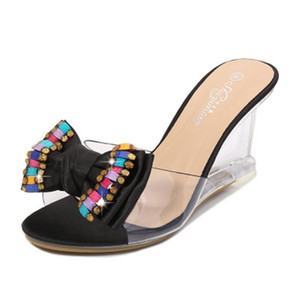 Тапочки Летняя обувь Женщины Хрустальный Лук 8 см Высокие каблуки Мулы Слайды Леди Прозрачный Флип Флоп Желлы Сандалии ЕС 34-43