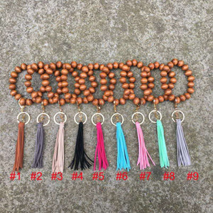 9 colors handmade wholesale stretched beaded keyring trendy popular elastic large wooden beads bracelet tassel keychain OWB2047
