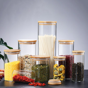 Botellas de almacenamiento de alimentos transparentes de vidrio Cubiertas de frascos Frascos de frascos para alimentos líquidos de arena Botellas de vidrio ecológicas con tapa de bambú