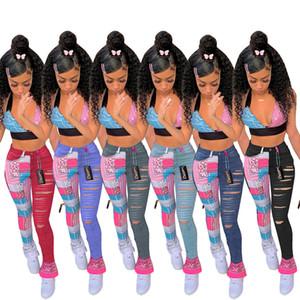 Diseñador Sexy Mujeres Jeans Impreso Tassel Slit Denim Lápiz Agujero Pantalones Casual Pantalones rectos Ladies Moda Pantalones de ocio