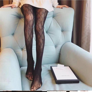 Sexy Long Bas Collants Femmes Fashion Noir et Blanc Mince Mince Mesh Collants Soux Souffle Hollow Letter Culotte Tuyau de haute qualité