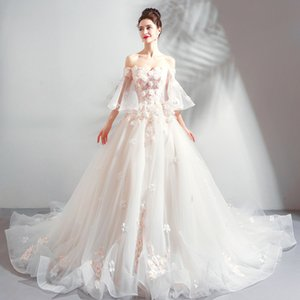 Fairies full charm Heavy industry noble elegance flowers off the shoulders of the bride big tuxedo wedding dress
