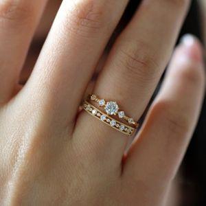 Korean version exquisite temperament simple daily joker sterling silver 14K gold five small zircon girlfriend ring wedding ring