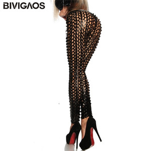 BIVIGAOS Fashion Women's Gothic Punk Rock Metal Bright Pierced Scales Hole Ripped PU Leather Elastic Sexy Leggings Stretch Pants Q1119
