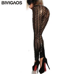 Bivigaos Fashion Gothique Punk Rock Metal Scales percées vif forfaval Hole déchiré PU Cuir Elastic Leggings sexy Stretch Pants Q1119