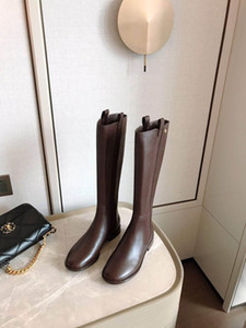 Ladies'leather thigh-high boots It's nice and comfortable It's not hard to walk Low heeled boots