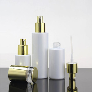 Luxury Makeup Container 60ml Glass Pump Bottle For Lotion Perfume With Shiny Silver And Shiny Gold Cap