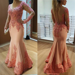 2021 Sexy Pink Mermaid Prom Dresses Sheer Back Buttons Appliques Lace Beads Hollow Cutaway Sides Long Sleeve Formal Evening Wear Party Gowns