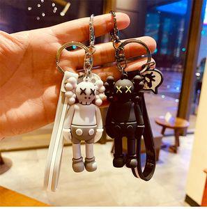 Violent bear dark kaws doll boys and girls ins tide brand personality creative keychain bag pendant pendant