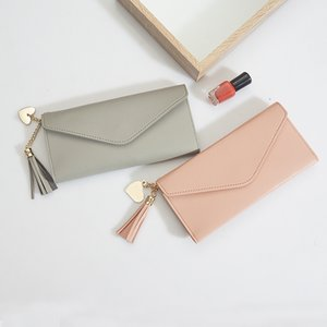Wholesale 2019 A New Purse The Female Long Korean Version Of Student Wallet Fashion And Contracted Love Tassels Buckle Wallets 19
