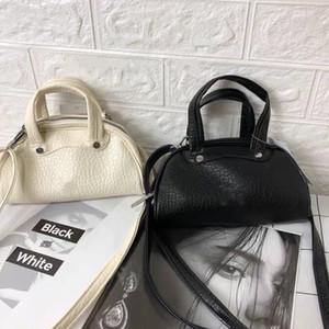 New AD fashion casual mini shell shape bag cross-body handbag.Black and white 2 colors optional
