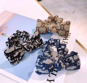 Designer Designer Letter Hair Gomma Banda Bowknot Lettera Elastico Capelli per capelli Ponytail Holder Accessori per capelli di Lusso