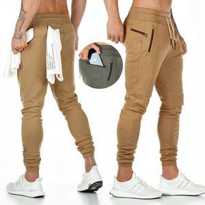 Sports pants male jogger fashion pocket design jogging pants new muscle men cotton gym fitness training pants X1116