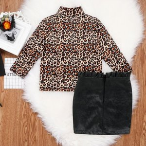 2021 new Children's new baby girls leopard print long-sleeved shirt + hip leather skirt children's two-piece suit