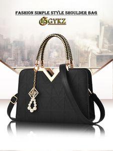 Gykz Brand Designer Bolso de hombro para bolsos de moda para mujer 2020 Nueva mujer Bolsas de cáscara de PU inusual C1223