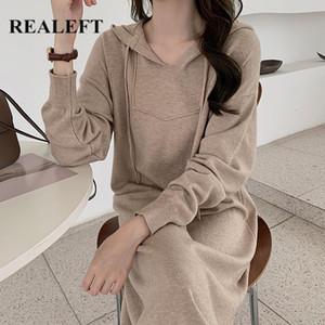 REALEFT minimalista Knitting com capuz Mulheres camisola Vestido Novo 2020 Outono Inverno manga comprida V-Neck solta de tamanho grande Vestido Midi