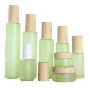 50Pcs lot 20g 20ml 30ml 40ml 50ml 60ml 80ml 100ml 120ml green Frost Glass Cream Jar Wooden line Cap Glass Lotion Spray Bottle