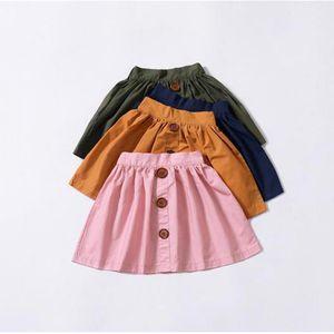 جديد القطن الطفل بنات التنانير الصيف تنورة أزرار بوهو نمط عارضة تنورة الأطفال بسيطة