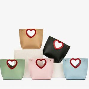 Bambini dei bambini di San Valentino Le vecchie ragazze amano il cuore Hollow PU Borse in pelle PU Bambini Catena metallica Borse a tracolla A5562