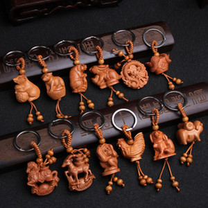 Этнический китайский 12 Zodiac Beychain Graving Wood Car Key Ring Creative Animal Horse Dragon Snake Snake Goat Chys Bear