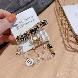 Hot Korean fashion brooch original design woolen cartoon iron tower pearl chain 5 word pin buckle badge brooch