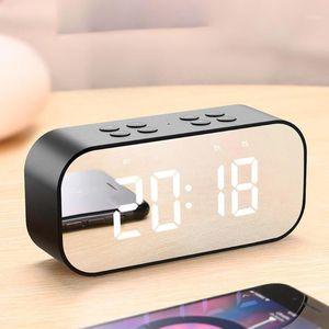 Hot Sale Mini alarm clock with FM radio wireless Bluetooth speaker support Aux TF USB music player wireless office bedroom1