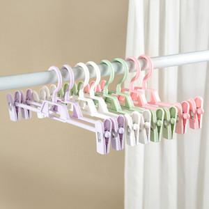 Plástico ajustável pálido pantspin calças cremalheiras ajustáveis aperto aperto de secagem saia plástica saia peg hanger scavor 169 N2
