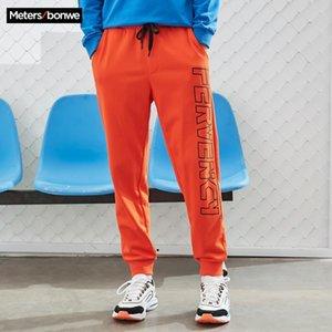 Metersbonwe Men Красивые спортивные брюки Новая Весна Осень Письмо Печать Луч Ноги Безвозмездная Брюки Мода Спорт Мужской Бренд Брюки Q0111