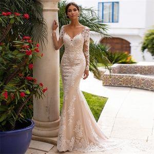 Jiayigong Champagne Mermaid Wedding Dresses Illusion Long Sleeves V-neck Lace Applique Backless Bridal Gown Vestido De Noiva Q1113