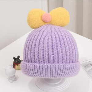 Cute and sweet bowknot children's knitted hat for fall winter baby curled woolen hat melon skin winter