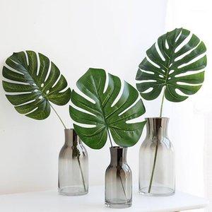 12 шт. Зеленое поддельное растение Palm папоротника черепаха листья пластиковые шелковые моды искусственные листья бытовые DIY моделирование свадьба дома декор1