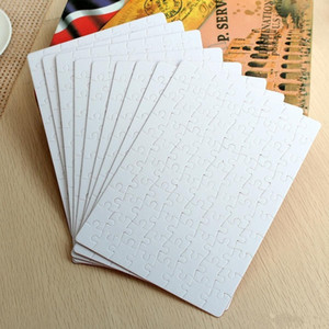 Sublimation Puzzle A4 Taille DIY SUBLIMATION Puzzles blancs Puzzle blanc Jigsaw 80pcs Transfert d'impression de chaleur Cadeaux à la main FY4295