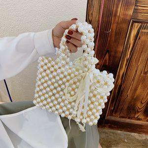 Retro woven Mary pearl handbag fashion lady party with shoulder bag bag basket pearl lady bag Handbag