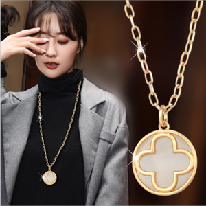 2021 Hot sale Autumn winter all-match sweater chain women's high-end long section two way worn hollow brass gold four-leaf clover necklace