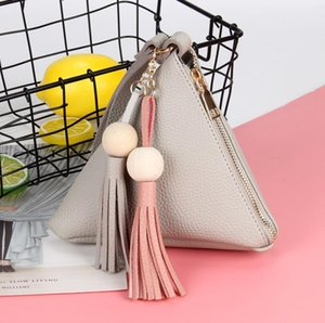 Korean version of the same 2021 mini small bag creative triangle wallet zongzi bag coin purse one drop