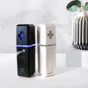 الوجه جزء الوجه المرطب USB تهمة عقد أدوات تكميلية المياه نانومتر الجمال تبخير الوجه أداة جديد وصول 9 75YS L1