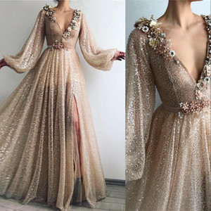 2021 Rose Gold Sequined Lace Sexy Arabic Dubai Evening Dresses Wear Deep V Neck Sequins Side Split Long Sleeves Plus Size Party Prom Gowns