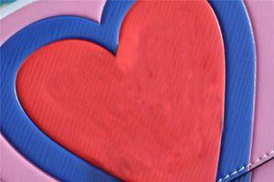 Jeu Sac à main à la chaîne PM avec une imprimée de coeur surdimensionnée colorée en gros chics chic-hop hip-hop sacs bandoulière femme bracelet sac M57460