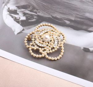 Europe and the United States new net red flash diamond pearl camellia brooch elegant temperament high-end personality floor fashion corsage