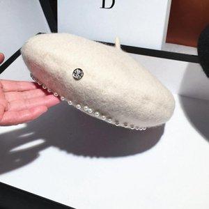 Nuevas mujeres 100% Woolen Beret Cap Winterh Cálido grueso francés Beret Hat Luxury Redondo Pearl Hip Hop Pumpkin Gorros Koud005