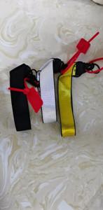 Toile Téléphone mobile Chaîne de porte-clés européen et américain Chiffre de marque avec pendentif Caméra bracelet