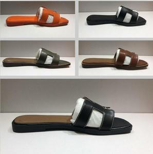 Lady Estilo original de alta calidad zapatillas de piel de oveja plana de alta calidad Sandalias de cuero genuinas Hot Women 2020 New Fashion Flat Pat Home Beach Zapatos Flip Floop
