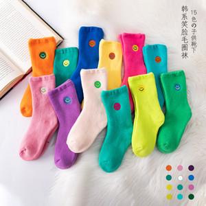 Estilo de moda invierno espesado calcetines de los niños dibujos animados bordado sonriente cara calcetines de toalla niños y niñas calcetines cálidos calcetines al por mayor