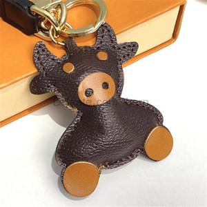 PU-Leder Ochsen Rinder Kuh Keychain Mode Männer Auto Schlüsselring Schlüssel Ringe Halter Frauen Bull Ochse Anhänger Weihnachten Neujahrsgeschenk mit Box
