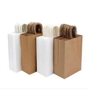 10pcs lot White Kraft paper bag with handles Wedding Party Bag Fashionable Clothes Gifts Packaging