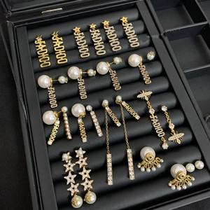 Pendientes de borla de la letra D del diseño D adecuados para las joyas de cristal largo y corto de las mujeres.