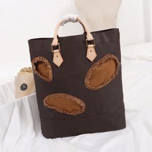 2021 Stile classico Donne Tote Bag Personality Hollow Signora Casual Borsa Casual Grande Capacità Borsa da viaggio per viaggi all'aperto