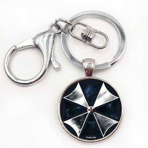 Pour résident Evil Parapluie Art Picture Verre Boîte Métal Keychain Vintage Mode Homme Porte-bague porte-clés pour voiture