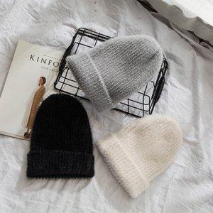 Moda invierno gorro de conejo sombreros hombres mujeres sólidos tapas de punto negro gris de piel largo sombrero sombrero unisex doble capa tela tapa