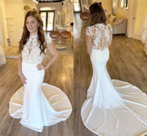 2021 Arabic Mermaid Wedding Dresses High Neck Cap Sleeves Elegant Lace Bridal Gowns Illusion Back Court Train Vestidos De Novia AL7837